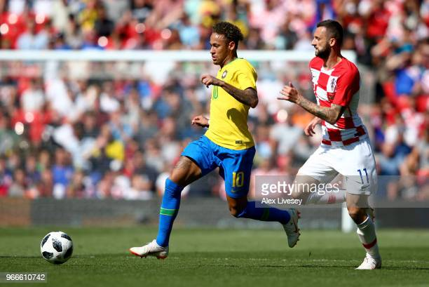 Neymar Jr of Brazil takes the ball away from Marcelo Brozovic of Croatia during the International Friendly match between Croatia and Brazil at...