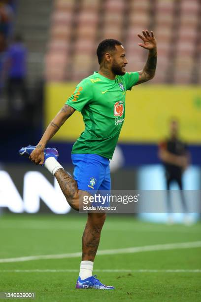 Neymar Jr. Of Brazil warms up prior to a match between Brazil and Uruguay as part of South American Qualifiers for Qatar 2022 at Arena Amazonia on...