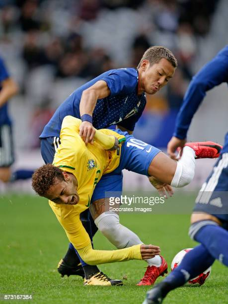 Neymar Jr of Brazil Yosuke Ideguchi of Japan during the International Friendly match between Japan v Brazil at the Stade Pierre Mauroy on November 10...