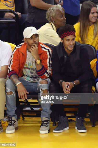 Neymar Jr of FC Barcelona and Racecar Driver Lewis Hamilton attend Game Two of the 2017 NBA Finals between the Cleveland Cavaliers and the Golden...