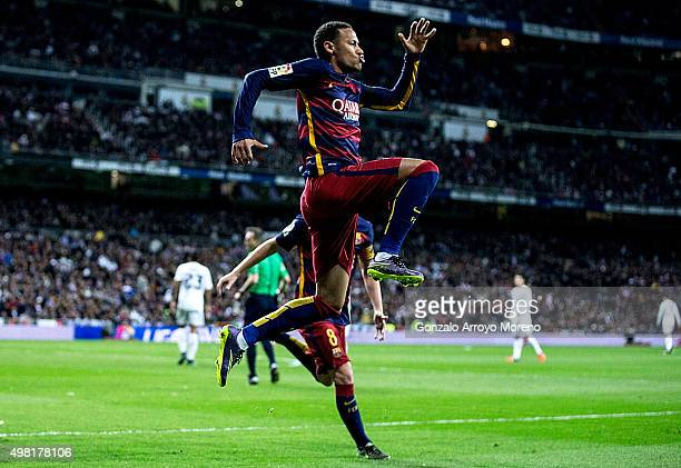 Neymar JR of FC Barcelona celebrates scoring their second goal during the La Liga match between Real Madrid CF and FC Barcelona at Estadio Santiago...