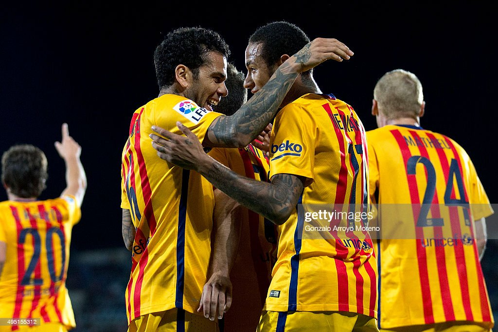 Neymar JR. (R) of FC Barcelona celebrates scoring their second goal with teammate during the La Liga match between Getafe CF and FC Barcelona at Coliseum Alfonso Perez on October 31, 2015 in Getafe, Spain.