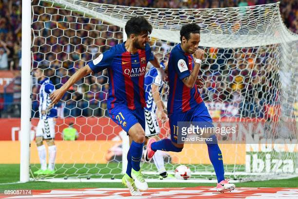 Neymar Jr of FC Barcelona celebrates with his team mate Andre Gomes of FC Barcelona after scoring his team's second goal during the Copa Del Rey...