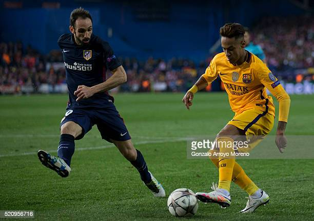 Neymar JR. Of FC Barcelona competes for the ball with Juan Francisco Torres alias Juanfran of Atletico de Madrid during the UEFA Champions League...