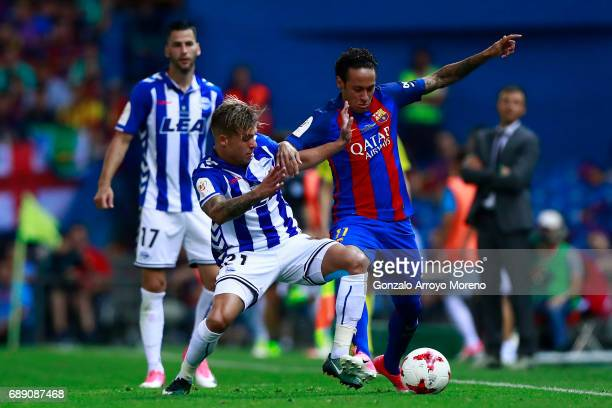 Neymar JR of FC Barcelona competes for the ball with Kiko Femenia of Deportivo Alaves during the Copa Del Rey Final between FC Barcelona and...