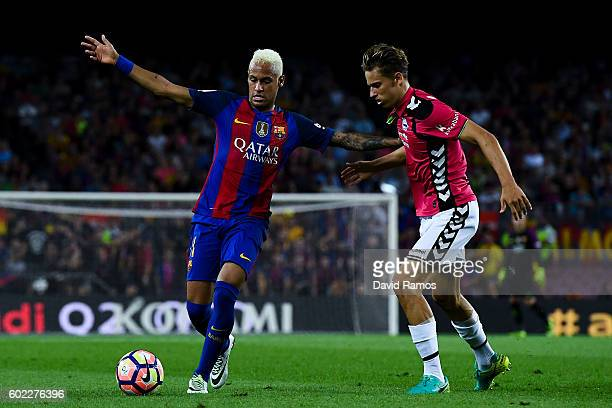 Neymar Jr of FC Barcelona competes for the ball with Marcos Llorente of Deportivo Alaves during the La Liga match between FC Barcelona and Deportivo...