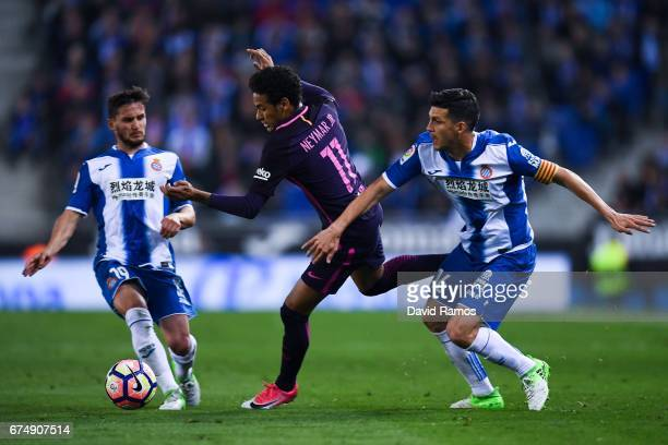 Neymar Jr of FC Barcelona competes for the ball with Pablo Piatti and Javi Lopez of RCD Espanyol during the La Liga match between RCD Espanyol and FC...