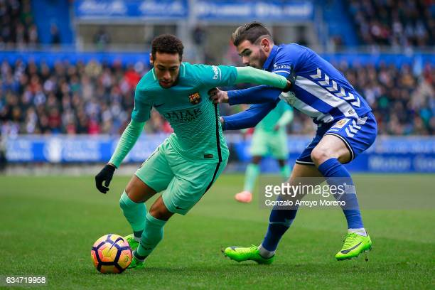 Neymar JR of FC Barcelona competes for the ball with Theo Hernandez of Deportivo Alaves during the La Liga match between Deportivo Alaves and FC...