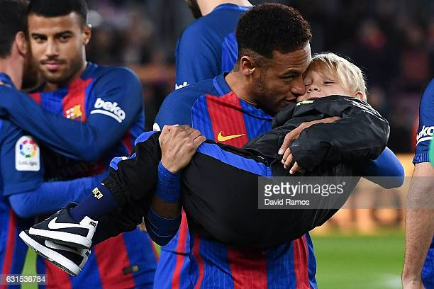 Neymar Jr of FC Barcelona hugs his son David Lucca prior to the kickoff of the Copa del Rey round of 16 second leg match between FC Barcelona and...