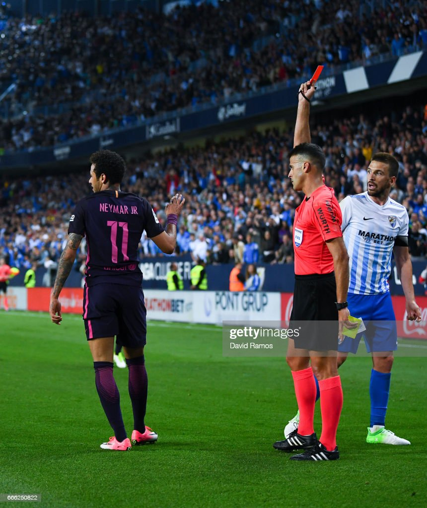Neymar Jr. of FC Barcelona is shown a red card during the La Liga match between Malaga CF and FC Barcelona at La Rosaleda stadium on April 8, 2017 in Malaga, Spain.