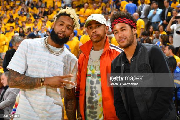 Neymar Jr of FC Barcelona poses for a photo with Racecar Driver Lewis Hamilton and New York Giant O'Dell Beckham Jr before Game Two of the 2017 NBA...