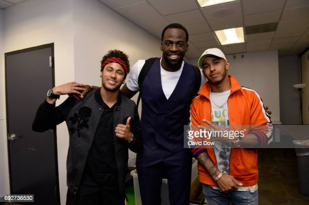 Neymar Jr of FC Barcelona poses with Draymond Green of the Golden State Warriors and Racecar Driver Lewis Hamilton after the game against the...