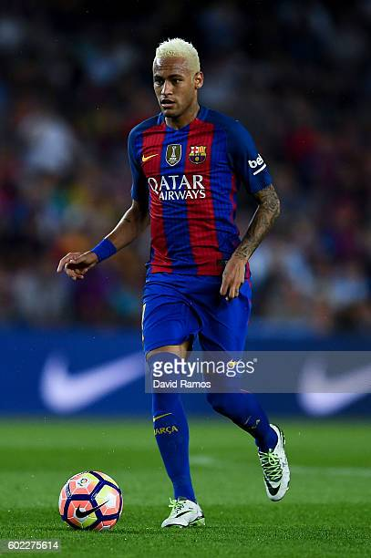 Neymar Jr of FC Barcelona runs with the ball during the La Liga match between FC Barcelona and Deportivo Alaves at Camp Nou stadium on September 10...