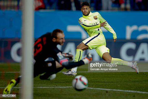 Neymar JR. Of FC Barcelona scores their opening goal during the Copa del Rey Round of 8 second leg match between Club Atletico de Madrid and FC...