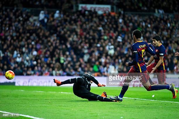 Neymar JR of FC Barcelona scores their second goal during the La Liga match between Real Madrid CF and FC Barcelona at Estadio Santiago Bernabeu on...