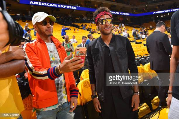 Neymar Jr of FC Barcelona talks to Racecar Driver Lewis Hamilton before Game Two of the 2017 NBA Finals between the Cleveland Cavaliers and the...
