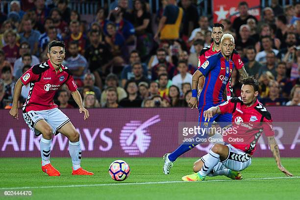 Neymar Jr of FCBarcelona competes for the ball with Daniel Torres and Raúl García of Deportivo Alavés during the Spanish League match between FC...