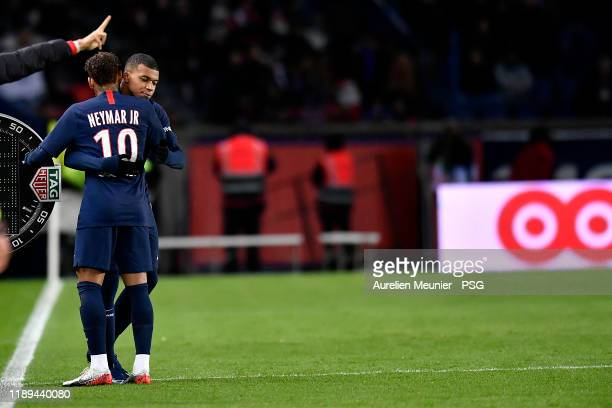 Neymar Jr of Paris SaintGermain acknowledges teammate Kylian Mbappe as he replaces him during the Ligue 1 match between Paris SaintGermain and Lille...