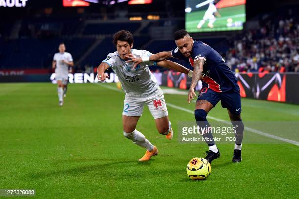 Neymar Jr of Paris Saint-Germain and Hiroki Sakai of Olympique de Marseille fight for the ball during the Ligue 1 match between Paris Saint-Germain...