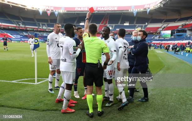 Neymar Jr of Paris Saint-Germain and Tiago Djalo of Lille OSC receive a red card during the Ligue 1 match between Paris Saint-Germain and Lille OSC...