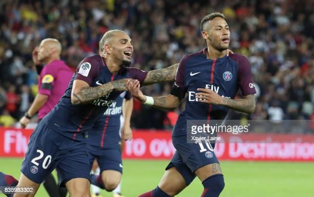 Neymar Jr of Paris SaintGermain celebrate his goal with Layvin Kurzawa during the French Ligue 1 match between Paris Saint Germain and Toulouse FC at...