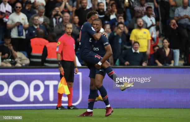 Neymar Jr of Paris SaintGermain celebrates his goal with Kylian Mbappe during the Ligue 1 match between Paris SaintGermain and SCO Angers at Parc des...