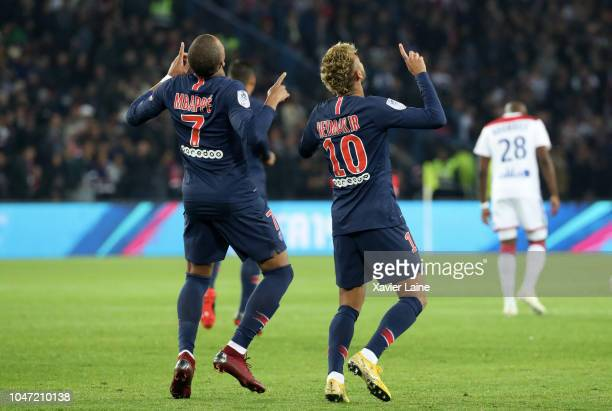 Neymar Jr of Paris SaintGermain celebrates his goal with Kylian Mbappe during the French Ligue 1 match between Paris Saint Germain and Olympique Lyon...