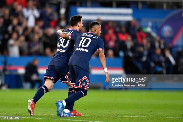 Neymar Jr of Paris Saint-Germain celebrates his goal with teammate Leo Messi during the Ligue 1 Uber Eats match between Paris Saint Germain and Lyon...