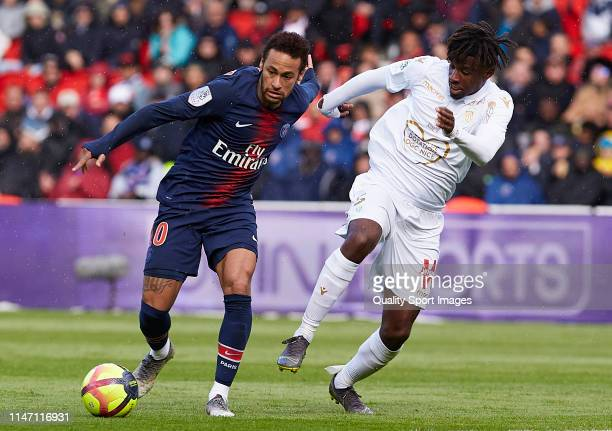 Neymar Jr of Paris Saint-Germain competes for the ball with Adrien Tameze of Nice during the Ligue 1 match between Paris Saint-Germain and OGC Nice...