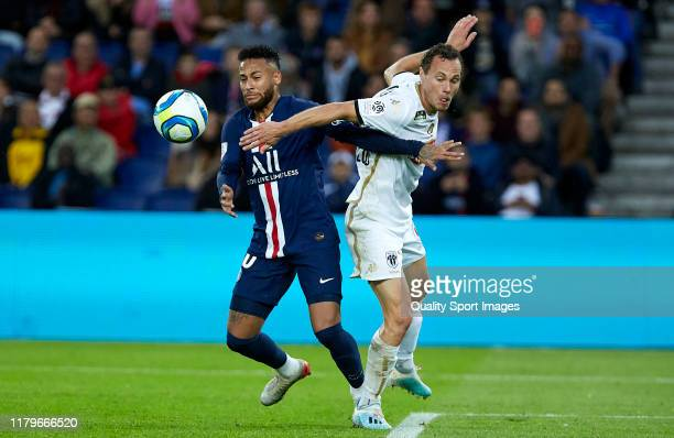 Neymar Jr of Paris Saint-Germain competes for the ball with Vincent Manceau of Angers during the Ligue 1 match between Paris Saint-Germain and Angers...