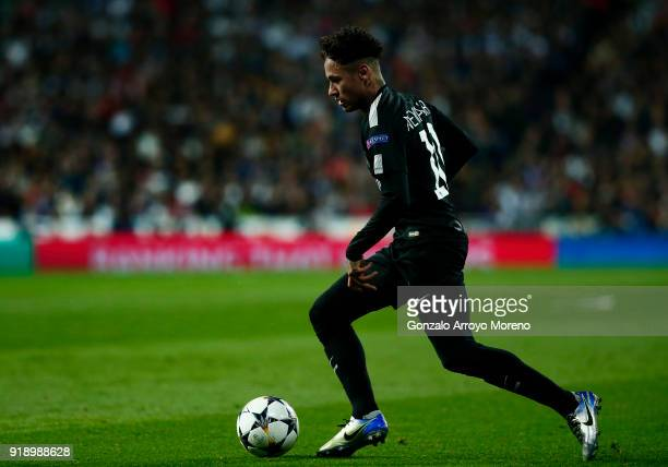 Neymar JR of Paris SaintGermain controls the ball during the UEFA Champions League Round of 16 First Leg match between Real Madrid and Paris...