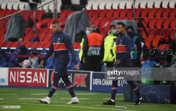 Neymar Jr of Paris SaintGermain enter the field with Kylian Mbappe during the UEFA Champions League Group H stage match between Paris SaintGermain...