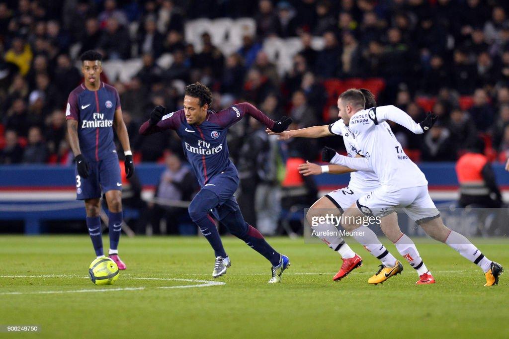 Neymar Jr of Paris Saint-Germain escapes from 2 defenders during the Ligue 1 match between Paris Saint Germain and Dijon FCO at Parc des Princes on January 17, 2018 in Paris.
