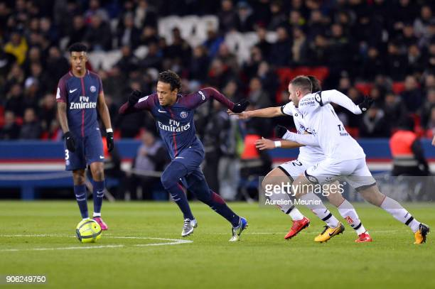 Neymar Jr of Paris SaintGermain escapes from 2 defenders during the Ligue 1 match between Paris Saint Germain and Dijon FCO at Parc des Princes on...