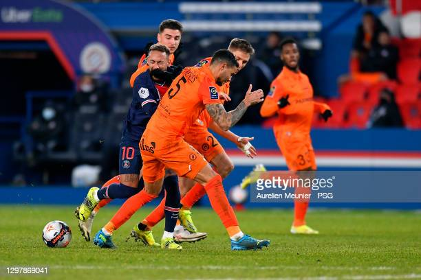 Neymar Jr of Paris Saint-Germain fights for the ball and get punched in the face during the Ligue 1 match between Paris Saint-Germain and Montpellier...
