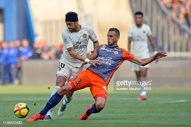 Neymar Jr of Paris SaintGermain fights for the ball during the Ligue 1 match between Montpellier HSC and Paris SaintGermain at Stade de la Mosson on...