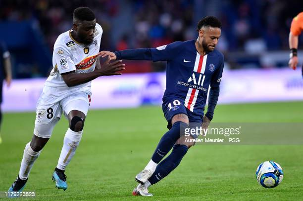 Neymar Jr of Paris SaintGermain fights for the ball during the Ligue 1 match between Paris SaintGermain and Angers SCO at Parc des Princes on October...