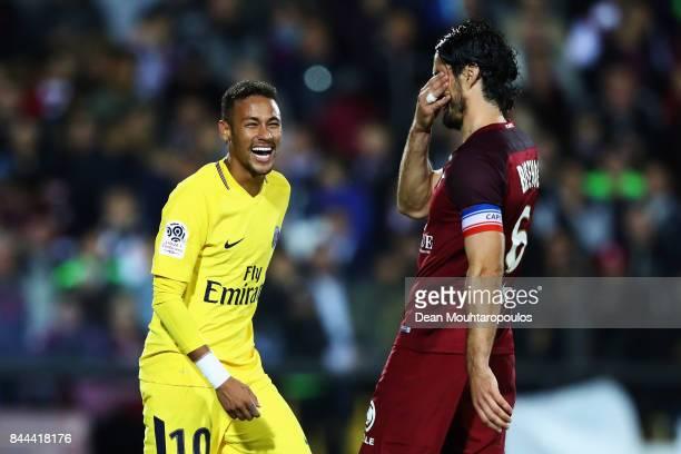 Neymar Jr of Paris Saint-Germain Football Club or PSG has a laugh with Milan Bisevac of Metz FC during the Ligue 1 match between Metz and Paris Saint...