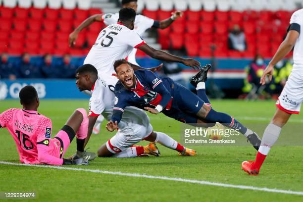 Neymar Jr of Paris SaintGermain gets fouled and falls on Junior Dina Ebimbe and Saturnin Allagbe of Dijon FCO during the Ligue 1 match between Paris...