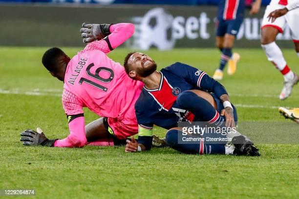 Neymar Jr of Paris SaintGermain gets hurt on Saturnin Allagbe of Dijon FCO during the Ligue 1 match between Paris SaintGermain and Dijon FCO at Parc...