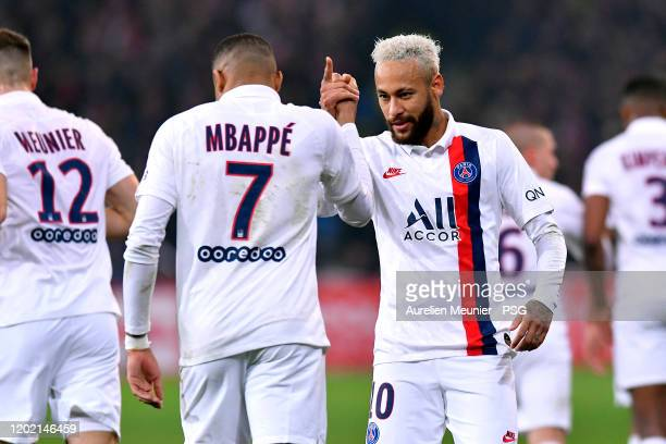 Neymar Jr of Paris SaintGermain handshakes with teammate Kylian Mbappe after scoring during the Ligue 1 match between Lille OSC and Paris...