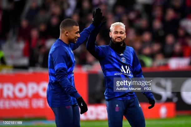 Neymar Jr of Paris Saint-Germain high fives Kylian Mbappe during warmup before the Ligue 1 match between Lille OSC and Paris Saint-Germain at Stade...