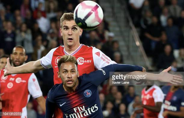 Neymar Jr of Paris Saint-Germain in action Bjorn Engels of Stade Reims during the French Ligue 1 match between Paris Saint Germain and Stade Reims on...