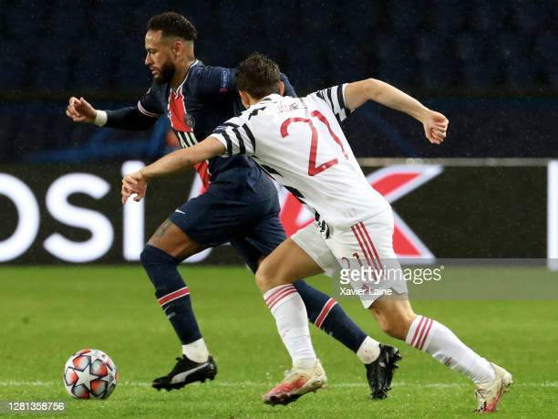 Neymar Jr of Paris SaintGermain in action with Daniel James of Manchester United during the UEFA Champions League Group H stage match between Paris...