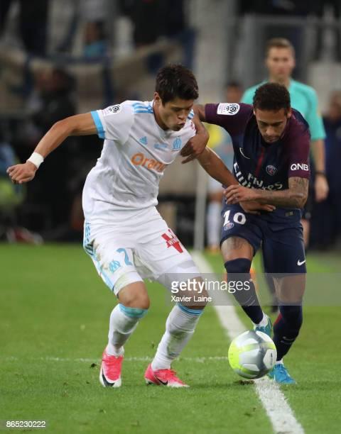 Neymar Jr of Paris SaintGermain in action with Hiroki Sakai of Olympique Marseille the Ligue 1 match between Olympique Marseille and Paris Saint...