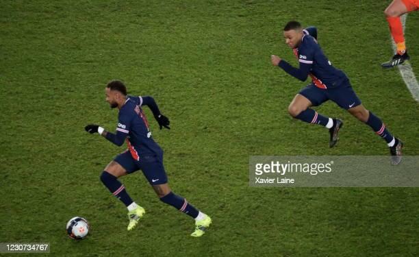 Neymar Jr of Paris Saint-Germain in action with Kylian Mbappe during the Ligue 1 match between Paris Saint-Germain and Montpellier HSC at Parc des...