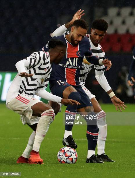Neymar Jr of Paris SaintGermain in action with Marcus Rashford of Manchester United during the UEFA Champions League Group H stage match between...