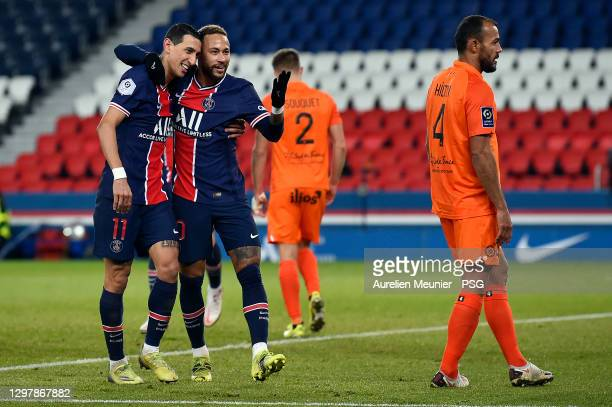 Neymar Jr of Paris Saint-Germain is congratulated by teammate Angel Di Maria after scoring during the Ligue 1 match between Paris Saint-Germain and...