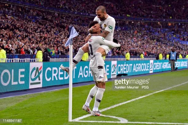 Neymar Jr of Paris Saint-Germain is congratulated by teammate Dani Alves after scoring during the French Cup Final match between Paris Saint-Germain...