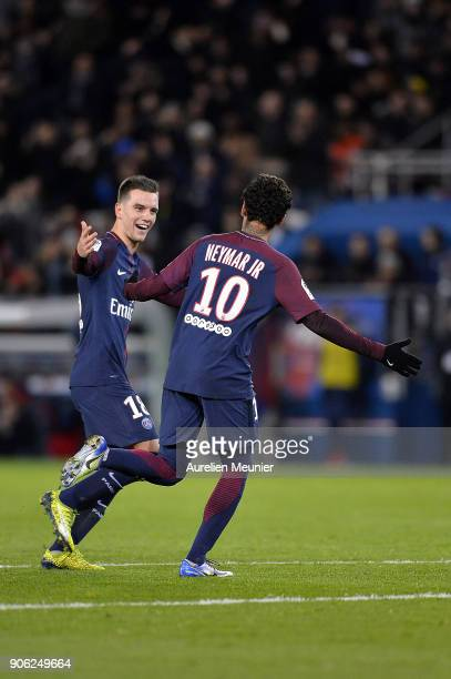 Neymar Jr of Paris SaintGermain is congratulated by teammate Giovani Lo Celso after scoring during the Ligue 1 match between Paris Saint Germain and...
